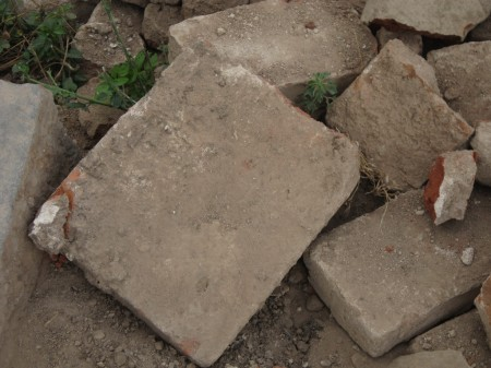 Bricks of the original temple - may be late pallava?